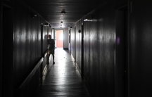 Two days after Hurricane Irma, an elderly resident stand in a dark hallway at Cypress Run, an assisted living facility without power, food, or water, in Immokalee, Florida, U.S., September 12, 2017.