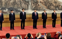 When it comes to running China, the most powerful officials in government are probably the members of the Politburo Standing Committee, lining up here for the news media at the Great Hall of the People in Beijing on October 25, 2017. But the man with the