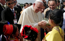 Pope Francis is welcomed as he arrives at Yangon International Airport, Myanmar November 27, 2017.