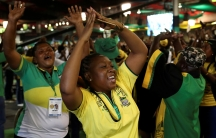 ANC members celebrate after Cyril Ramaphosa was elected president of the ANC in Johannesburg, South Africa.