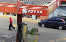 The corporate logo of the state oil company PDVSA is seen at a gas station in Caracas,