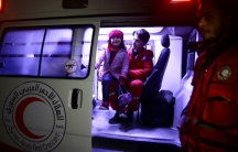 A girl is seen in an ambulance during medical evacuation from eastern Ghouta late Tuesday.
