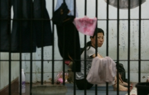Cheong-Suk Ryang, 36, a defector from North Korea hoping to reach South Korea via Thailand, sits in her cell at the Chiang Saen police station in Thailand, after she and four other North Korean women were arrested on the Thai-Lao border. Photo taken May 9