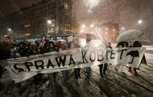 "Banner reads ""Women's rights — women's business"""