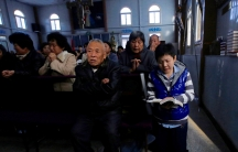 Believers take part in a weekend service at an underground Catholic church in the Chinese city of Tianjin on November 10, 2013.