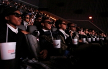 Students from the Capital Preparatory Harlem School watch a screening of the film