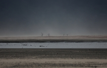 Sand blows across a normally submerged area at Theewaterskloof dam near Cape Town, South Africa, January 20, 2018.