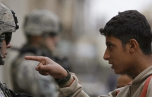 A resident gestures as he talks to a U.S. soldier from 2nd Brigade combat team, 82nd Airborne on patrol in Baghdad's Adhamiya district January 5, 2008.