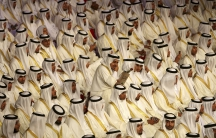 Saudi men gather in anticipation of a group wedding aided by the government