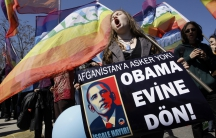 """A Turkish demonstrator holds a banner in Istanbul in April 2009. It reads, """"No soldiers for Afghanistan. Return to your home Obama."""""""
