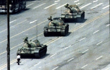 The famous 'tank man', alone and unarmed, stands passively in front of a convoy of tanks on the Avenue of Eternal Peace in Tiananmen Square on June 5, 1989. The iconic image is banned in China but has permeated popular and protest culture around the globe
