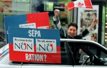 """A """"No"""" supporter yells from a moving car while taking his message through the streets of downtown Montreal during Quebec's 1995 referendum on secession from Canada."""