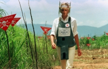 Princess Diana walks through a minefield in Angola, 1997
