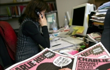 The copies of the French satirical weekly Charlie Hebdo seen in their Paris newsroom on February 9, 2006. In this and other issues, the magazine published cartoons that angered Muslims.