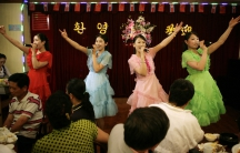 Singing waitresses entertain crowds at a North Korean restaurant in the Chinese border city of Dandong, on May 28, 2009.