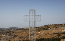 A giant cross stands on top of the Mount Qanat Bakish in Lebanon, in a photo from Oct. 1, 2010.