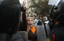 An anti-government protester gestures during clashes with police in Cairo January 26, 2011.
