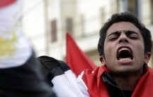 An anti-government protester participates in demonstrations against Egyptian President Hosni Mubarakin in front of the presidential palace in Cairo, Feb. 11, 2011.