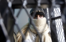 A suspected al-Qaeda militant waiting at the state security court of appeals in Sanaa in March, 2013.  Many young men in Yemen get swept up in security crackdowns and become radicalized in jail.