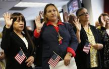 Immigrants take the oath of citizenship during a naturalization ceremony to become new citizens of the U.S. in New York.