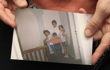 Patimat Suleimanova, aunt of Boston bombing suspects Dzhokhar and Tamerlan Tsarnaev, holds a photo from the family archive at her house in Makhachkala.