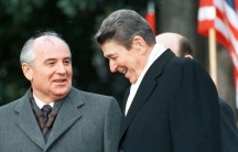 Former U.S. President Ronald Reagan (R) stands with former Soviet leader Mikhail Gorbachev (L) during Gorbachev's arrival ceremony at the White House in Washington, December 8, 1987.