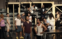 "Director Andy Senor Jr. (C) takes part in a rehearsal for the musical ""Rent"" in Havana November 25, 2014."