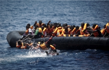 Migrants fall into the water during a rescue in the Mediterranean.