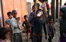 Children drink water from the SHRI sanitation system.