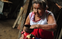 Zahit Salazar used to earn a little money selling clothes she bought near the southern border with Mexico. But Mexico's new checkpoints have made that too difficult. She's had to fall back on grinding corn to make tamales.