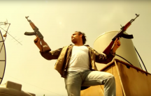 An actor fires guns from a rooftop in Beirut in a short satirical video made by Cheyef 7alak, a Lebanese advocacy group, to highlight the dangers of celebratory gunfire.