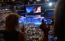 Delegates watch the Democratic Women of the Senate address at the DNC in Philadelphia.