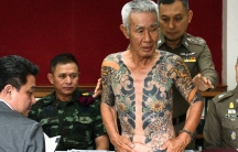 Shigeharu Shirai (C), a 74-year-old Japanese man accused of a gang murder in Japan 15 years ago attends a news conference at a police station, after being detained by police in Lopburi province, Thailand, Jan. 11, 2018.