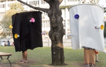 """People in a Yangon try out the """"soundsuit,"""" an art installation that's designed to draw attention to noise. """"Maybe once people hear what they sound like,"""" says one of the creators, """"they'll reduce the noise."""""""