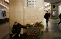 A man mourns next to a memorial site for the victims of a blast in the St. Petersburg subway on April 4.