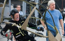 """Actor Stephen Lang performing in an """"amp suit,"""" with director James Cameron by his side"""