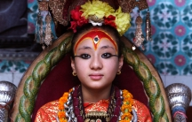 The Living Goddess, known as a Kumari Devi, is worshipped in Nepal by Hindus and Buddhists alike. Each Kumari Devi is chosen at a very young age. Samita, the girl in this picture, is no longer a Kumari Devi. Since the photo was taken, she started mentruat