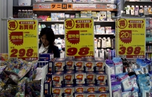A shopper is seen at a drug store in Tokyo. Chances are that this store will play Auld Lang Syne to alert shoppers that it's closing time.