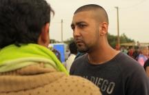 Syed Bokari talks to migrants at the 'Jungle' camp in Calais, France