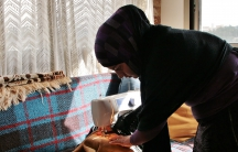 Hiba Bekai's office is her home, where she sews and does other needle work that she sells to Syrians and Lebanese.