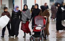Syrian women walking