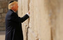 President Donald Trump places a note in the stones of the Western Wall, Judaism's holiest prayer site, in Jerusalem's Old City, on May 22.