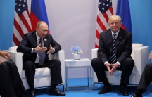 Russia's President Vladimir Putin talks to President Donald Trump during their bilateral meeting in Germany.