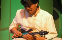 """""""Mandolin"""" Srinivas performs a live show in Pune, India, in 2009. The musician introduced his electric mandolin into India's ancient Carnatic music."""