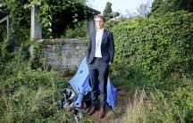 David Hyde stands in front of his tent in Geneva, Switzerland.
