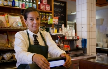 Sally Teixeira studied to be a medical administrative assistant, but she now works at a deli in Cambridge, Mass.