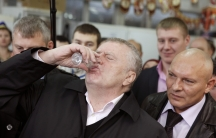 Vladimir Zhirinovsky, leader of the Liberal Democratic Party of Russia, drinks a shot of vodka while visiting a market as part of his party Duma election campaign in the southern Russian city of Stavropol.