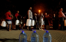 People queued to collect water as fears over the city's water crisis grew earlier this year in Cape Town, South Africa.