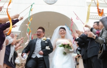 An LGBT couple in Japan celebrate their nuptials.