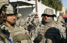 Wisam Albaiedhani (left) interpreting for US troops in Iraq.